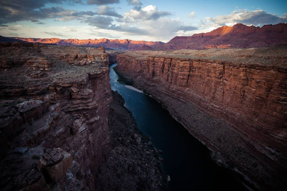 Sunset on the Colorado River at the end of Grand Canyon near Navajo Bridge, Arizona. According to scientists it took the Colorado River about 20 million years to create the Grand Canyon
